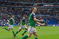 GOAL CELEBRATION - Northern Ireland's Jonny Evans celebrates his sides second goal with teammates<br /> <br /> Photographer Craig Mercer/CameraSport<br /> <br /> International Football - 2016 UEFA European Championship - Group C, Ukraine v Northern Ireland - Thursday, 16th June 2016 - Stade de Lyon, Lyon, France<br /> <br /> World Copyright © 2016 CameraSport. All rights reserved. 43 Linden Ave. Countesthorpe. Leicester. England. LE8 5PG - Tel: +44 (0) 116 277 4147 - admin@camerasport.com - www.camerasport.com