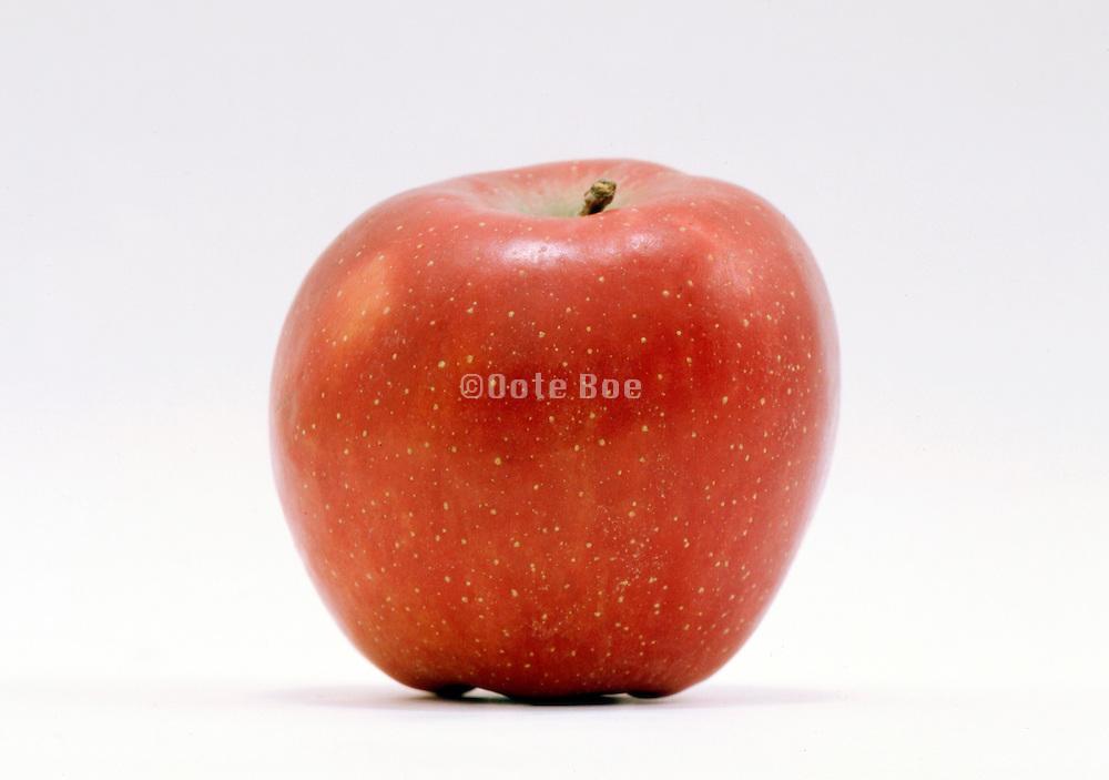 still life of freckled red apple