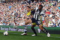 Swansea City's Michu shields the ball from  West Bromwich Albion's Gareth McAuley<br />  (Photo by Kieran Galvin/CameraSport) <br /> <br /> Football - Barclays Premiership - West Bromwich Albion v Swansea City - Sunday 1st September 2013 - The Hawthorns - West Midlands<br /> <br /> © CameraSport - 43 Linden Ave. Countesthorpe. Leicester. England. LE8 5PG - Tel: +44 (0) 116 277 4147 - admin@camerasport.com - www.camerasport.com