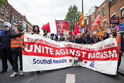 Southall, UK. 27th April 2019. Shadow Chancellor John McDonnell joins members of the local community and supporters on a march through Southall to honour the memories of Gurdip Singh Chaggar and Blair Peach on the 40th anniversary of their deaths. Gurdip Singh Chaggar, a young Asian boy, was the victim of a racially motivated attack whilst Blair Peach, a teacher, was killed by the Metropolitan Police's Special Patrol Group during a peaceful march against a National Front demonstration.