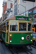 Melbourne, Australia - August 31, 2017: A man drives the Route 35 City Circle Tram (Free Tourist Tram) near Flinders Station in the Central Business District of Melbourne.