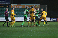 tempers flare between AFC Wimbledon striker Tyrone Barnett (23) and Newport County midfielder Joss Labadie (6) during the EFL Trophy Southern Group B match between Newport County and AFC Wimbledon at Rodney Parade, Newport, Wales on 8 November 2016. Photo by Stuart Butcher.