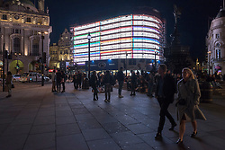 © Licensed to London News Pictures. 13/09/2017. London, UK. .  The new giant advertising screen in Piccadilly Circus is seen being tested behind scaffolding.  Switched off in January 2017, the previous screens have been replaced by Europe's largest single digital, ultra-high definition curved screen measuring 8,500 sq ft (790 sq m) and is due to be unveiled iun Autumn 2017.  Advertisers will be able to take advantage of the screen's ability to rotate between six full-motion sections, which will be shared, while also having the chance to harness brief single-brand takeovers of the complete screen.   Photo credit : Stephen Chung/LNP