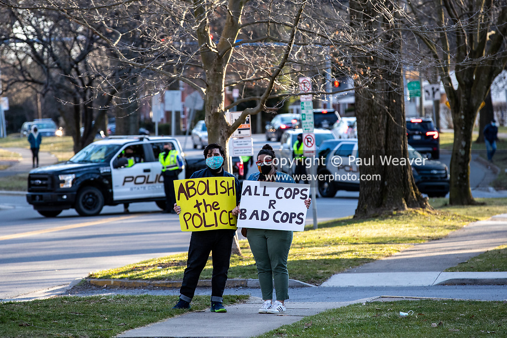 Protesters hold signs in State College, Pennsylvania on March 19, 2021. The 3/20 Coalition organized a protest and march to mark the second anniversary of Osaze Osagie being shot and killed by State College police at his apartment. (Photo by Paul Weaver)