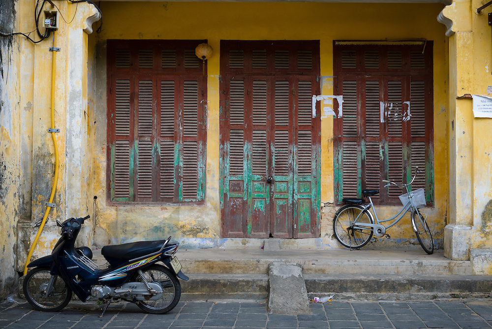 Motorbike in front of traditional architecture in Hoi An ancient town