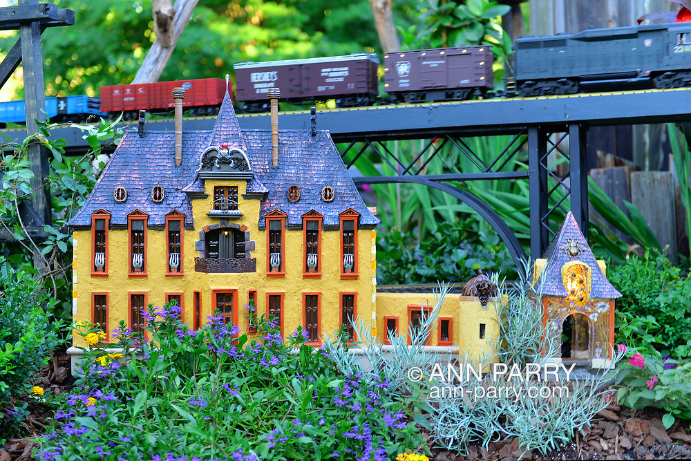 Old Westbury, New York, U.S. June 23, 2021. Old Westbury Gardens has an opening reception for its Great Pine Railway outdoor model train exhibit. The orange Oheka Castle, of Huntington, is one of several Long Island landmarks Leslie Salka Inc created for the unique large G gauge model railroad exhibit, which runs until September 6.
