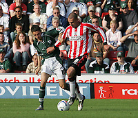 Photo: Lee Earle.<br /> Southampton v Plymouth Argyle. Coca Cola Championship. 24/09/2005. Plymouth's Matt Derbyshire (L) and Danny Higginbotham battle for the ball.