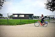 Nederland, Millingen aan de Rijn, 1-10-2014De nieuwe sportkantine van SC Millingen en DKV Odio. Gemeente Millingen zal bestuurlijk samengaan met Ubbergen en Groesbeek. Het is een artikel 12 gemeente, te klein om zichzelf te bedruipen en heeft grote bestuurlijke problemen. Centrum van de Millingerwaard.Foto: Flip Franssen/Hollandse Hoogte