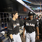 NEW YORK, NEW YORK - July 05: Barry Bonds #25 of the Miami Marlins talking with Christian Yelich #21 of the Miami Marlins in the dugout before an at bat during the Miami Marlins Vs New York Mets regular season MLB game at Citi Field on July 05, 2016 in New York City. (Photo by Tim Clayton/Corbis via Getty Images)