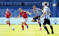 Nottingham Forest's Ryan Yates under pressure from Sheffield Wednesday's Connor Wickham<br /> <br /> Photographer Rich Linley/CameraSport<br /> <br /> The EFL Sky Bet Championship - Sheffield Wednesday v Nottingham Forest - Saturday 20th June 2020 - Hillsborough - Sheffield <br /> <br /> World Copyright © 2020 CameraSport. All rights reserved. 43 Linden Ave. Countesthorpe. Leicester. England. LE8 5PG - Tel: +44 (0) 116 277 4147 - admin@camerasport.com - www.camerasport.com