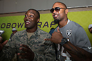 January 27 2016: Oakland Raiders Charles Woodson poses for a photo with a fan during the Pro Bowl Draft at Wheeler Army Base on Oahu, HI. (Photo by Aric Becker/Icon Sportswire)