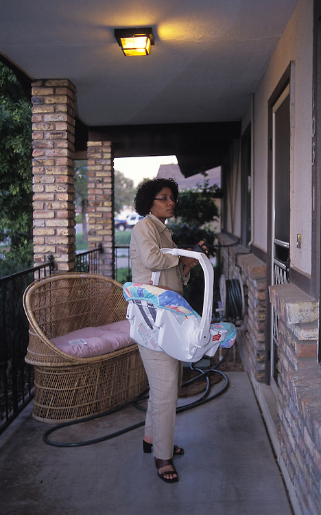Child Protective Services caseworker Germaine Abraham-LeVeen brings an 8-month-old baby girl to a foster home in the East Valley after removing the child from her parents who were homeless and using the child to pandhandle. The baby was thin and filthy..