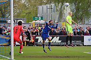 AFC Wimbledon defender George Francomb (7) with a header on goal during the EFL Sky Bet League 1 match between AFC Wimbledon and Peterborough United at the Cherry Red Records Stadium, Kingston, England on 17 April 2017. Photo by Matthew Redman.