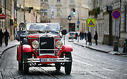 """SHOT 11/23/08 5:28:33 AM - Touring the Malá Strana section of Prague in a historic automobile. Malá Strana, both meaning in English literally """"Little Side"""", though more frequently referred to as """"Lesser Town"""", """"Lesser Quarter"""", or """"Lesser Side"""") was originally a popular and nowadays also the official name for the former Men?í m?sto pra?ské (""""The Lesser Town of Prague""""), one of Prague's historical and oldest boroughs. Its name comes from its position on the left (west) bank of the river Vltava, on the slopes just below the Prague Castle, in opposition to the larger towns of Prague on the right bank, to which it is conjoined by the Charles Bridge. In the Middle Ages, it was a dominant centre of the ethnic German citizens of Prague. It also housed a large number of noble palaces while the right-bank towns were comparatively more bourgeois and more Bohemian Czech. Prague is the capital and largest city of the Czech Republic. Its official name is Hlavní m?sto Praha, meaning Prague, the Capital City. Situated on the River Vltava in central Bohemia, Prague has been the political, cultural, and economic centre of the Czech state for over 1100 years. The city proper is home to more than 1.2 million people, while its metropolitan area is estimated to have a population of over 1.9 million. Since 1992, the extensive historic centre of Prague has been included in the UNESCO list of World Heritage Sites. According to Guinness World Records, Prague Castle is the largest ancient castle in the world. Nicknames for Prague have included """"the mother of cities"""", """"city of a hundred spires"""" and """"the golden city"""". Since the fall of the Iron Curtain, Prague has become one of Europe's (and the world's) most popular tourist destinations. It is the sixth most-visited European city after London, Paris, Rome, Madrid and Berlin. Prague suffered considerably less damage during World War II than some other major cities in the region, allowing most of its historic architecture to stay true to form."""