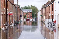 Houses in flooded street after torrential rain caused flooding in Oxford and the Thames Valley area; July 2007,