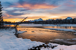 """Winter sunset at the Snake  River in Grand Teton National Park<br /> <br /> For production prints or stock photos click the Purchase Print/License Photo Button in upper Right; for Fine Art """"Custom Prints"""" contact Daryl - 208-709-3250 or dh@greater-yellowstone.com"""