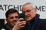 Fulham manager Claudio Ranieri takes a selfie with a fan after arriving in the team coach for The FA Cup 3rd round match between Fulham and Oldham Athletic at Craven Cottage, London, England on 6 January 2019.