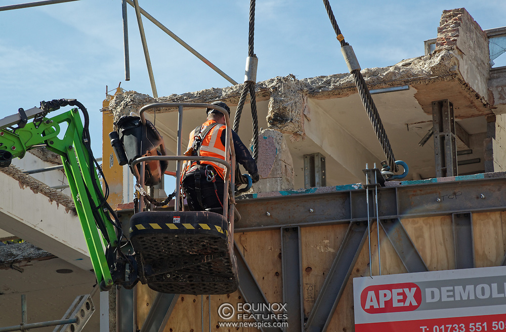 London, United Kingdom - 20 September 2019<br /> EXCLUSIVE SET - Aerial construction specialists and demolition experts use a huge crane to carefully lift intact, a twenty five ton, two-story wall, to preserve a famous Banksy rat image which has been covered up for years. Teams from specialist companies have spent over six weeks cutting around the artwork and fitting custom made eight ton steel supports to enable them to save the historic piece of art. Work has started on the construction of a new twenty seven floor art'otel hotel on the site of the old Foundry building in Shoreditch, east London, and a condition of the planning permission was to preserve the historical Banksy graffiti. A second section of the painting, an image of a TV being thrown through a broken window has already been cut out and moved separately. After the hotel construction is complete the two parts of the Banksy painting will be displayed on the hotel. Our pictures show the stages of work to protect the image, culminating in the lifting of the three story wall by crane. Video footage also available.<br /> (photo by: EQUINOXFEATURES.COM)<br /> Picture Data:<br /> Photographer: Equinox Features<br /> Copyright: ©2019 Equinox Licensing Ltd. +443700 780000<br /> Contact: Equinox Features<br /> Date Taken: 20190920<br /> Time Taken: 13081187<br /> www.newspics.com