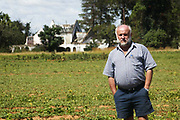 Evicted white farmer Joe Waley stands in a crop field in front of the farmhouse of the white farmer made famouse three years ago when he was killed and his dog lay on his body. His farm had been looted and destroyed by Zimbabweans trying to oust the local white farmers from Zimbabwe.