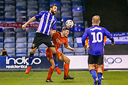 Sheffield Wednesday forward Atdhe Nuhiu (17) beats Luton Town defender Matthew Pearson (6) and heads the ball during the The FA Cup 3rd round replay match between Luton Town and Sheffield Wednesday at Kenilworth Road, Luton, England on 15 January 2019.