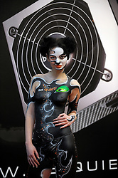 HANNOVER, GERMANY - MARCH-7-2008 - be-quiet! the German manufacturer of award winning PC power supplies employed a model clad only in a thong and body paint to attract visitors to their booth - and it worked!  (Photo © Jock Fistick)