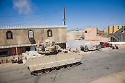 Actors stage a crisis situation in Medina Wasl, a fabricated Iraqi village  at Camp Irwin, in California's Mojave Desert. The village is used for training soldiers deploying to Iraq.
