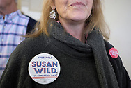A supporter wears a pin originally printed before redistricting during during a canvass launch event for Susan Wild, Democratic candidate for Pennsylvania's new 7th Congressional District, with Senator Bob Casey on Oct. 13, 2018, at a democratic campaign office in Bethlehem, Pennsylvania.