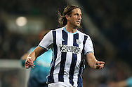 Jonas Olsson of West Bromwich Albion looks on. Premier league match, West Bromwich Albion v Swansea city at the Hawthorns stadium in West Bromwich, Midlands on Wednesday 14th December 2016. pic by Andrew Orchard, Andrew Orchard sports photography.