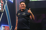 Thumbs up from Noel Malicdem after reaching the second round during the World Darts Championships 2018 at Alexandra Palace, London, United Kingdom on 19 December 2018.