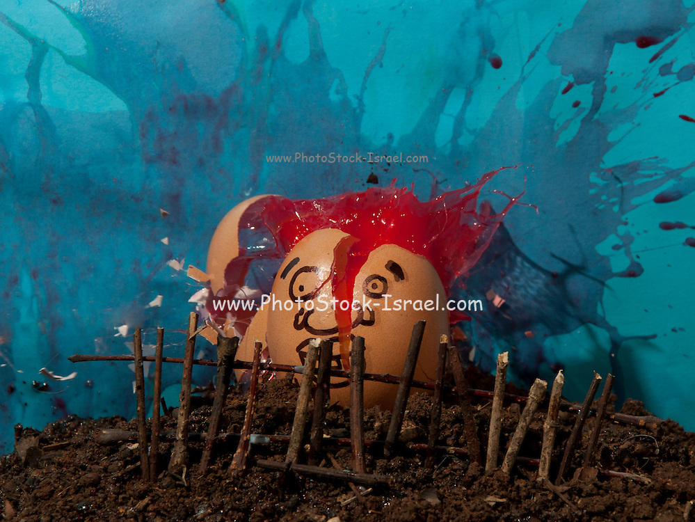Stop motion of a an egg shell with a face exploding. Red liquid bursts out of the shell