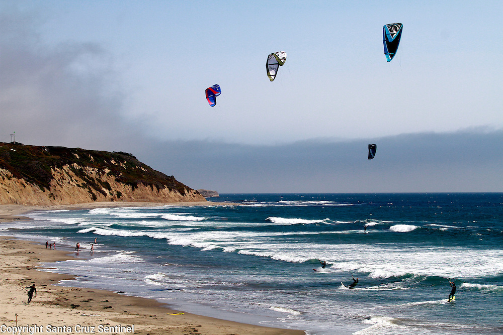 Kite surfers and windsurfers fill the water at Waddell Creek State Beach.<br /> Photo by Shmuel Thaler <br /> shmuel_thaler@yahoo.com www.shmuelthaler.com