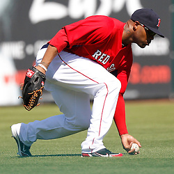 February 28, 2011; Fort Myers, FL, USA; Boston Red Sox left fielder Carl Crawford (13) scoops up a ground ball during a spring training exhibition game against the Minnesota Twins at City of Palms Park.  Mandatory Credit: Derick E. Hingle