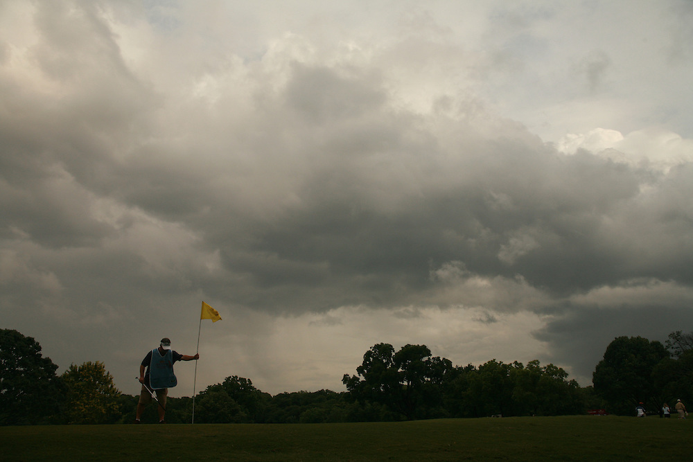 FORT WORTH, TX - MAY 26:  General view of a caddie replacing the flag on the second green as weather moves induring the third round of the 2007 Crowne Plaza Invitational At Colonial tournament in Fort Worth, Texas at Colonial Country Club on Saturday, May 26, 2007. (Photo by Darren Carroll/Getty Images) *** LOCAL CAPTION***