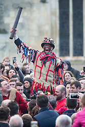 """© Licensed to London News Pictures. 06/01/2016. Haxey UK. Picture shows Dale Smith """"the fool"""" addressing the crowd at The Haxey Hood that takes place today, The historic event dating back to the 14th century sees teams representing four pubs in Haxey & Westwoodside compete for a leather cylinder known as the hood. After a pub crawl around the participating pubs, the game begins with a famous speech from the ceremonial fool. The game is won when the scrum reaches one of the pubs and the hood is touched by the landlord or landlady. Photo credit: Andrew McCaren/LNP"""