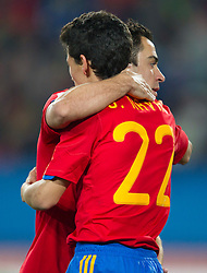 Xavi and Jesus Navas of Spain when Navas  felt in penalty area and there was penalty shot for Spain during the 2010 FIFA World Cup South Africa Group H Second Round match between Spain and Honduras on June 21, 2010 at Ellis Park Stadium, Johannesburg, South Africa.   (Photo by Vid Ponikvar / Sportida)