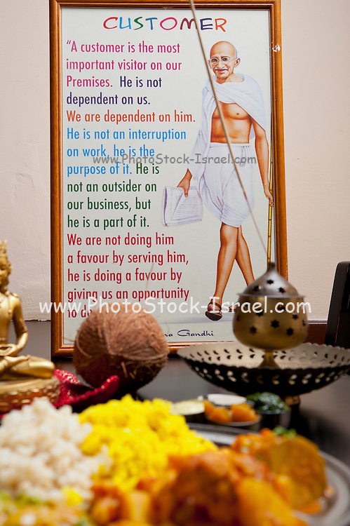 Mahatma Gandhi and a statement about the importance of the customer Indian Ethnical Food Vegetarian Thali in the foreground