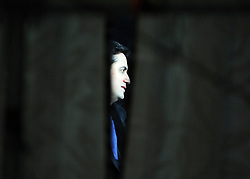 © Licensed to London News Pictures. 29/09/2011. LONDON, UK. Ed Miliband, the Leader of the Labour Party takes part in a live TV interview,  pictured through a curtain, in a temporary studio in the conference arena at The Labour Party Conference in Liverpool today (29/09/11). Photo credit:  Stephen Simpson/LNP