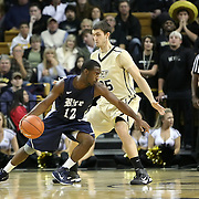 Bryan Beasley (12) drives past Central Florida forward A.J. Tyler (25) during a Conference USA NCAA basketball game between the Rice Owls and the Central Florida Knights at the UCF Arena on January 22, 2011 in Orlando, Florida. Rice won the game 57-50 and extended the Knights losing streak to 4 games.  (AP Photo/Alex Menendez)