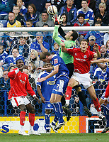 Photo: Steve Bond.<br /> Leicester City v Barnsley. Coca Cola Championship. 27/10/2007. Keeper martin Fulop safely gathers under pressure from Stephen Foster (L)