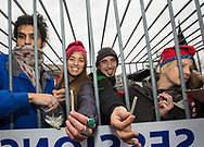 People stand in a giant cage while giving out 4,200 free joints given out on Jan, 20, 2017 in Washington D.C at Dupont Circle during a protest the morning of Donald Trump's<br />  inauguration. the group, DCMJ that organized the protest is  against Donald Trump's pick of  Jeff Session as Attorney General due to his anti Marijuana stance. <br /> At four minutes and twenty seconds into Trump's Inauguration, protesters plan to light up the joints.