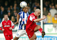Photo: Chris Ratcliffe.<br />Colchester United v Swindon Town. Coca Cola League 1. 18/03/2006.<br />Chris Iwelumo (L) of Colchester tussles with Andrew Gurney of Swindon
