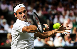 LONDON, July 5, 2017  Switzerland's Roger Federer hits a return during the men's singles first round match against Ukraine's Alexandr Dolgopolov at the Championship Wimbledon 2017 in London, Britain, on July 4, 2017. Federer advanced to the second round after Dolgopolov retired due to injury. (Credit Image: © Han Yan/Xinhua via ZUMA Wire)