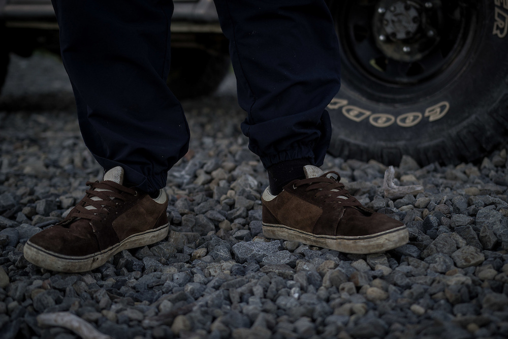 WELLINGTON, NEW ZEALAND - July 8:  Stanley Adams' shoes while he stands in front of his truck on the rugged south coast of Wellington. July 8, 2015 in Wellington, New Zealand.  REAL PEOPLE.  (Photo by Matt Silcock/ real-people.co.nz)