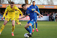 AFC Wimbledon midfielder Callum Reilly (33) dribbling and battles for possession with Fleetwood Town  defender Harry Souttar (6) during the EFL Sky Bet League 1 match between AFC Wimbledon and Fleetwood Town at the Cherry Red Records Stadium, Kingston, England on 8 February 2020.