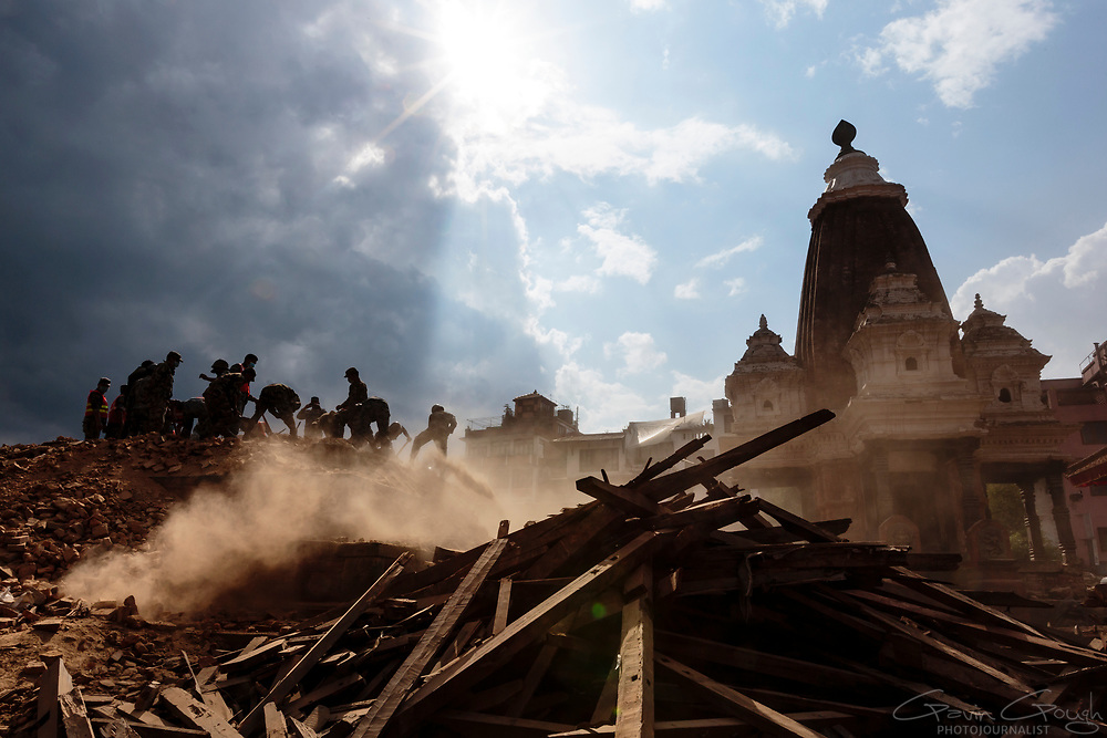 Soldiers from the Nepal Army search through the rubble of an ancient Hindu temple in Patan's Durbar Square.