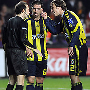 Referee's Cuneyt CAKIR (L) and Fenerbahce's Diego Alfredo Lugano MORENO (R), Mehmet TOPUZ (C) during their Turkish superleague soccer derby match Galatasaray between Fenerbahce at the AliSamiYen Stadium at Mecidiyekoy in Istanbul Turkey on Sunday, 28 March 2010. Photo by TURKPIX