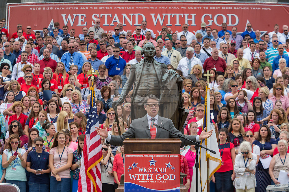 """Former Texas Gov. Rick Perry in front of a statue of George Washington, address a gathering of evangelical Christians during the """"Stand With God"""" rally  August 29, 2015 in Columbia, SC. Thousands of conservative Christians gathered at the State House to rally against gay marriage and listen to GOP presidential candidates Gov. Rick Perry and Sen. Ted Cruz speak."""
