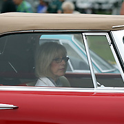 A lady sits in a 1957 Duel Ghia D-500 at the Greenwich Concours d'Elegance Festival of Speed and Style featuring great classic vintage cars. Roger Sherman Baldwin Park, Greenwich, Connecticut, USA.  2nd June 2012. Photo Tim Clayton