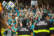 Milpitas High School juniors cheer on their classmates as they perform the opening dance during the annual Trojan Olympics, where students compete in various unorthodox events for class bragging rights, at Milpitas High School in Milpitas, California, on March 27, 2015. (Stan Olszewski/SOSKIphoto)