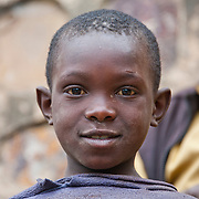 A young boy in Gatovu Community in Kisaro Sector, Rulindo District, Rwanda.